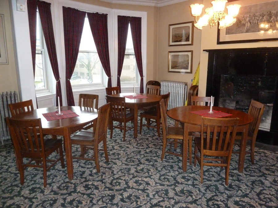 The membership gathers around the tables for meals and receptions held in The Rooms.