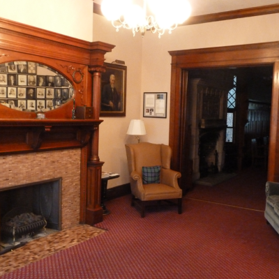 The parlor is a comfortable room where members can peruse Scottish magazines or enjoy the company of other members.
