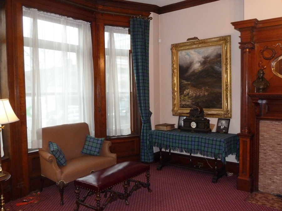 Paintings and memorabilia of the Society enhance the ambience of the room.