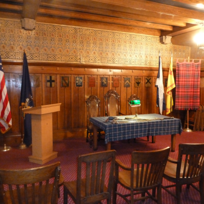 The meetings of the Society are conducted by the President, who along with the Treasurer and Secretary is seated at a table that holds the Society�s claymore.