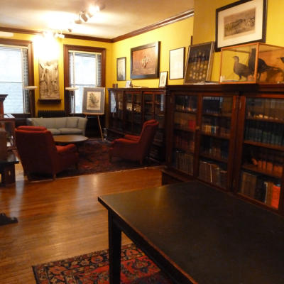 Pictures, artifacts and historic documents are displayed on the walls of the library.